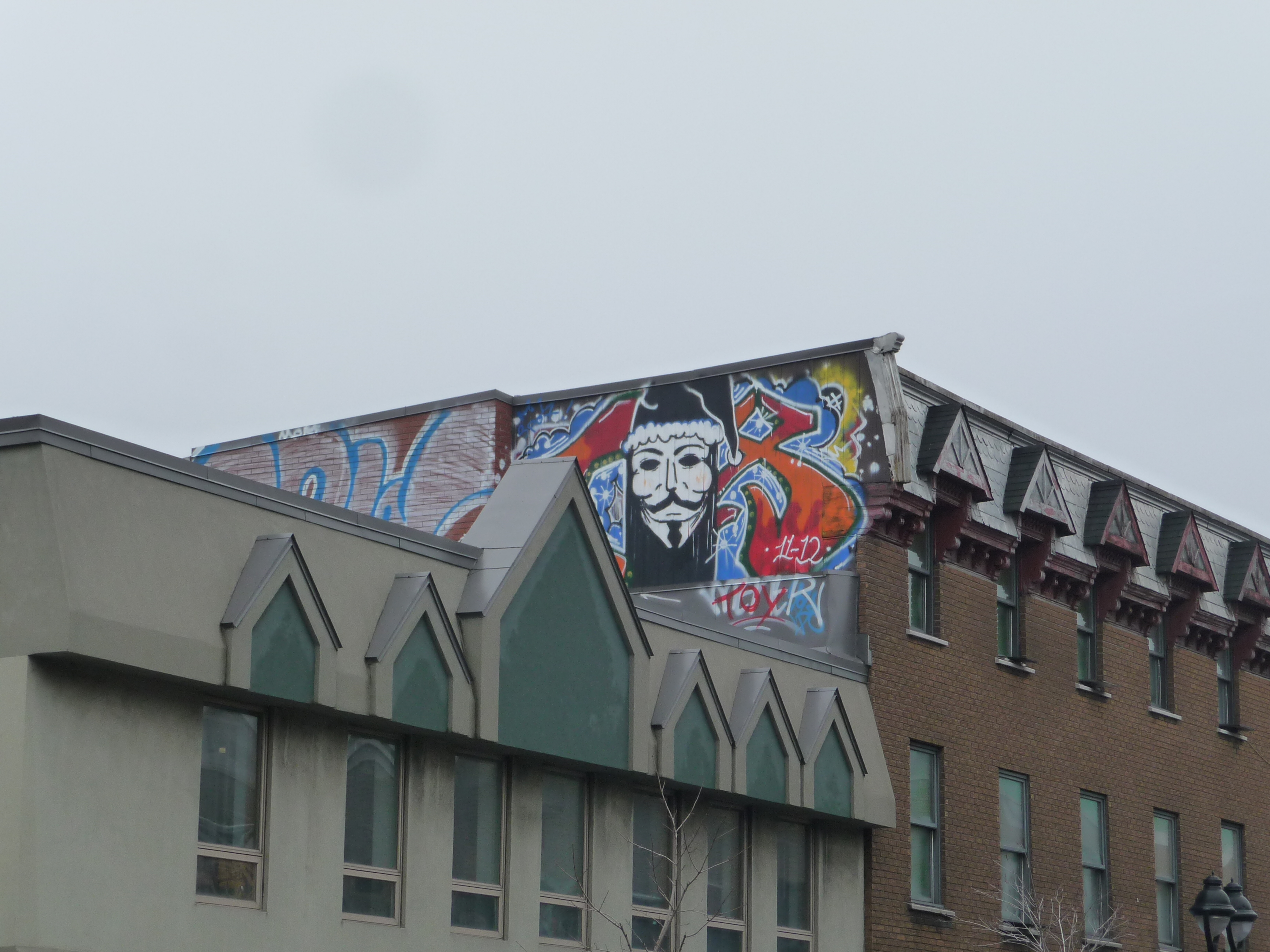 Guy_Fawkes_Mask_Graffiti_Montreal_16_March_2012