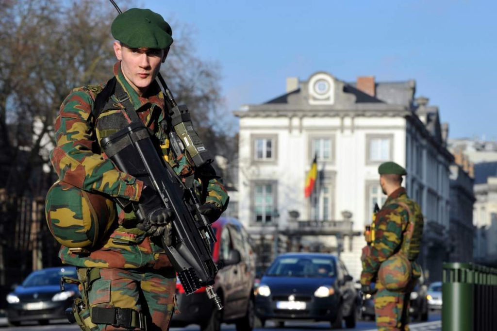 Belgian soldiers guard outside the U.S. Embassy in Brussels near the Belgian Parliament