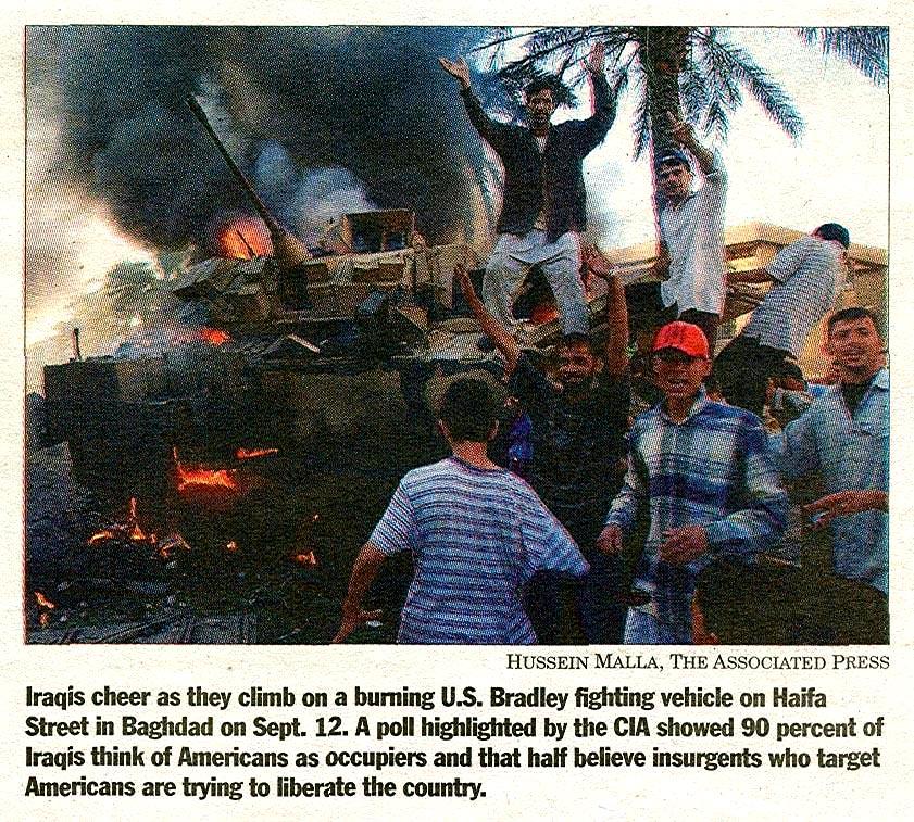 iraqis celebrate over destroyed bradley