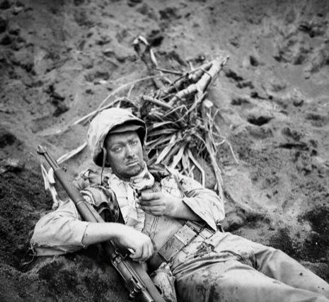 wounded marine awaits evacuation on iwo feb 1945