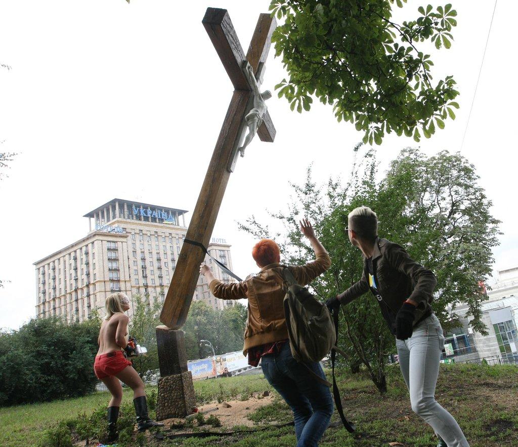 """""""Femen"""" desecrating crosses in Kiev, Ukraine."""