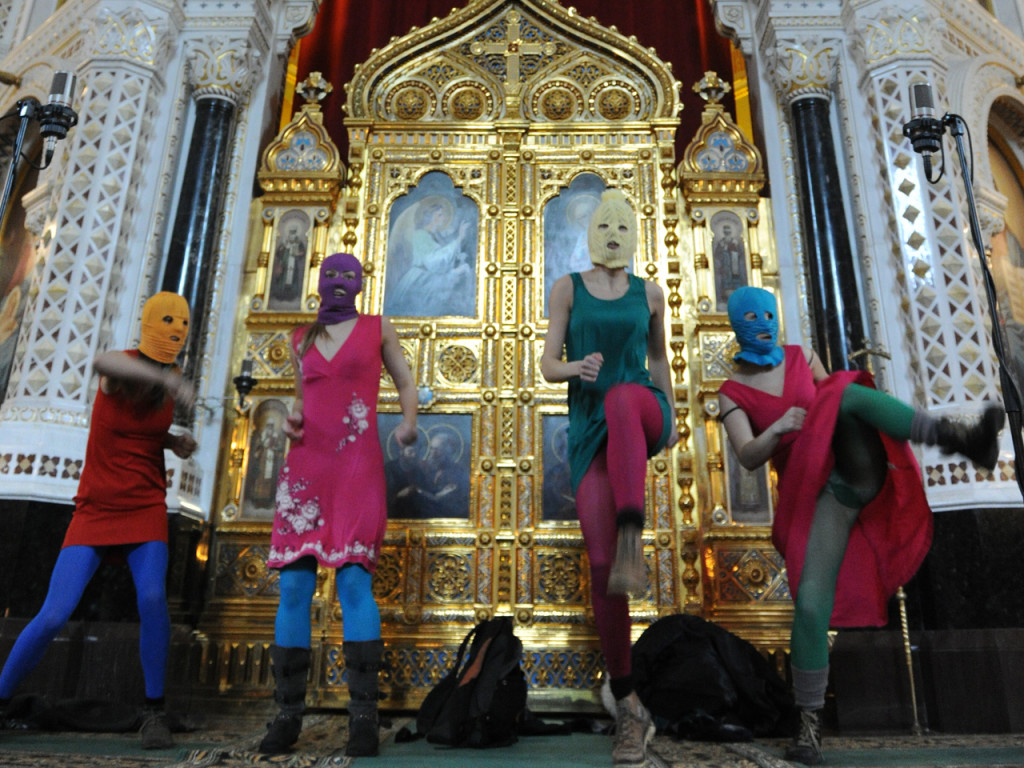 """""""Pussy Riot"""" interrupting a solemn church service at Moscow's Cathedral of Christ the Savior on 12 February 2012."""